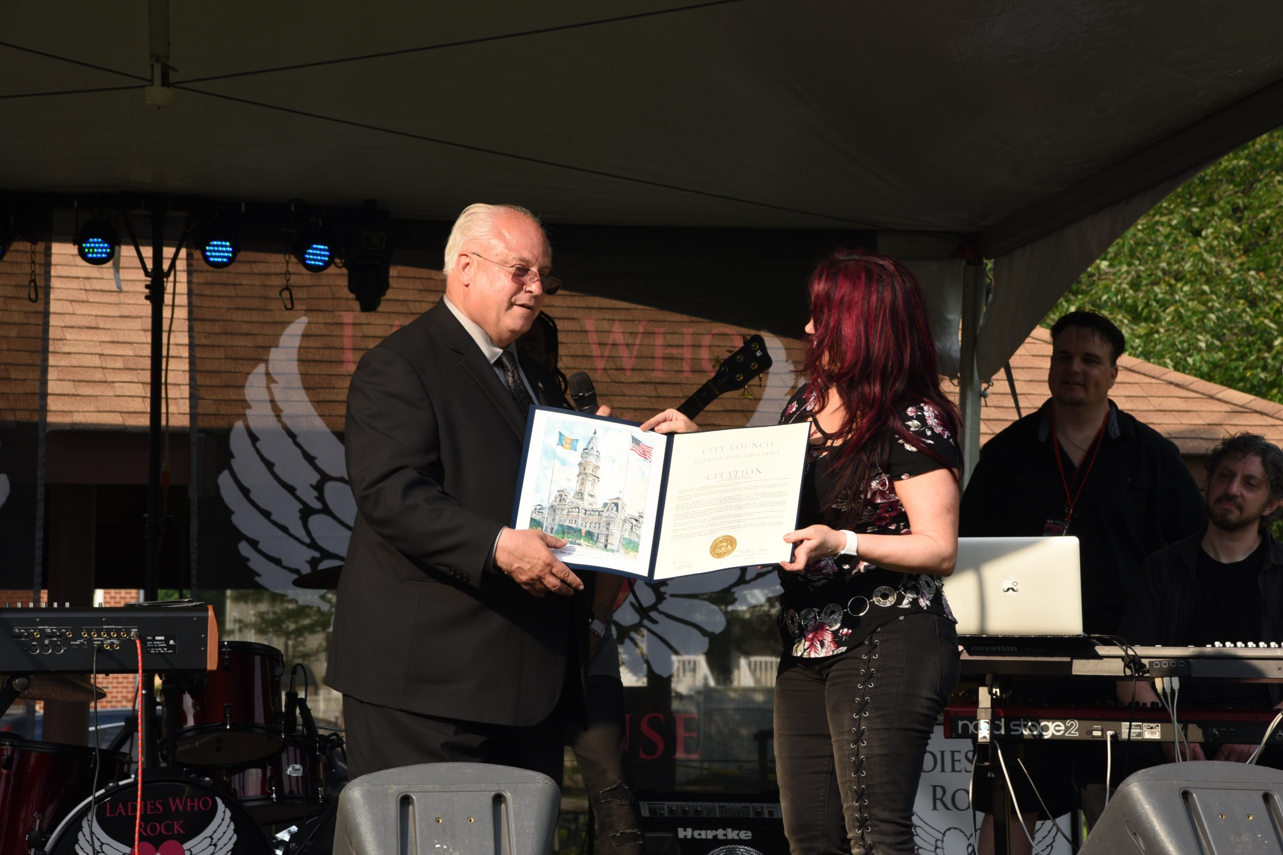 Sharon Lia Pres & CEO being presented with a commendation for the work of LWRFAC, from Philadelphia city councilman-at-large Al Taubenberger at 2018 Festival.