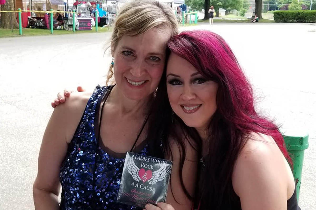 michele_bebelestrange_ and sharon holding first ever LWR4AC CD
