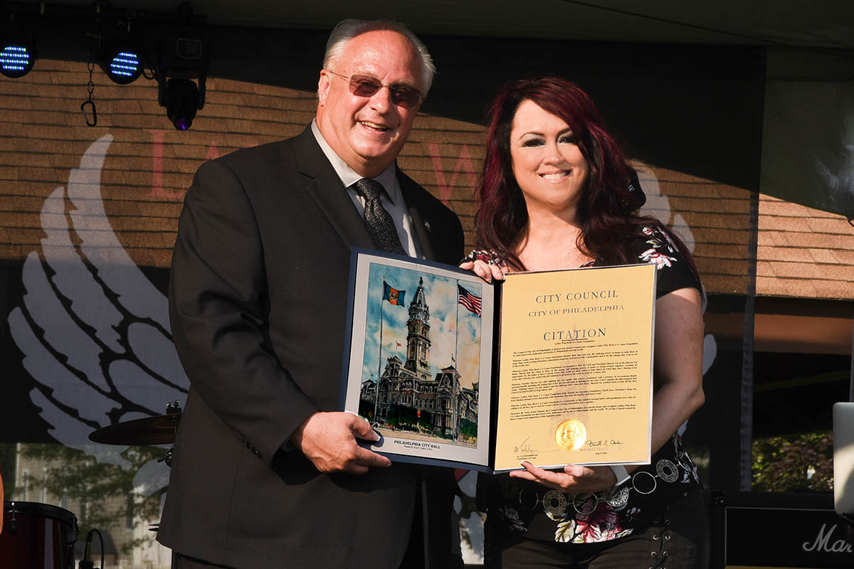 al taubenberger city councilman at large, presents official honorary citation to sharon lia of Sharon Lia Band and ceo of lwr4ac
